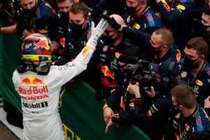 Sergio Perez, Red Bull Racing, 3rd position, celebrates with his team in Parc Ferme