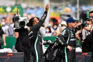 Lewis Hamilton, Mercedes, waves from Parc Ferme after securing pole