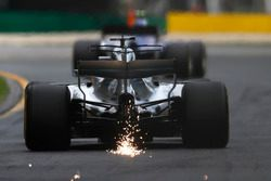 Sparks fly from the rear of Lewis Hamilton, Mercedes AMG F1 W08