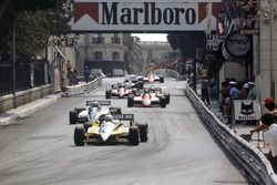 Rene Arnoux, Renault RE30B leads Riccardo Patrese, Brabham BT49D-Ford Cosworth, Bruno Giacomelli, Alfa Romeo 182, Alain Prost, Renault RE30B and Didier Pironi, Ferrari 126C2