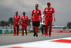 Sebastian Vettel, Ferrari and Riccardo Adami, Ferrari Race Engineer walk the track