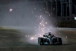 Lewis Hamilton, Mercedes AMG F1 W08, kicks up sparks under braking