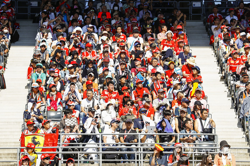 Fans watch the race from a grandstand