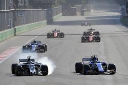 Romain Grosjean, Haas F1 Team VF-17 locks up and battles, Pascal Wehrlein, Sauber C36