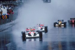Ayrton Senna leads teammate Gerhard Berger, both McLaren MP4/6 Honda's, Nigel Mansell, Williams FW14