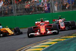 Kimi Raikkonen, Ferrari SF70H, leads Kevin Magnussen, Haas F1 Team VF-17 and Jolyon Palmer, Renault