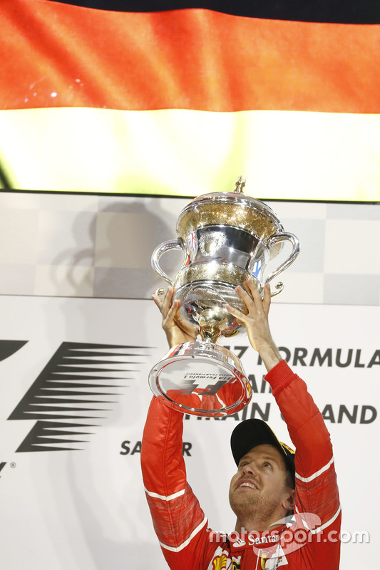 Sebastian Vettel, Ferrari, 1st Position, celebrates on the podium with his trophy
