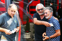 (L to R): Gerhard Berger, with Flavio Briatore, and Eddie Jordan