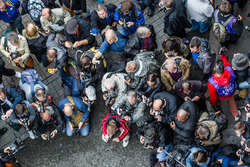 Fans take photos of the #7 Audi Sport Team Joest Audi R18 and #8 Audi Sport Team Joest Audi R18 e-tr