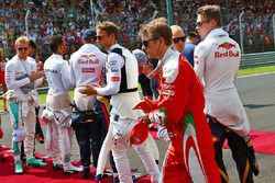 Kimi Raikkonen, Ferrari as the grid observes the national anthem