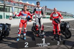 Drag race podium: winner Scott Redding, Pramac Racing, second place Casey Stoner, Ducati Team, third