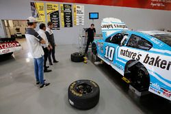 Romain Grosjean, Haas F1 Team, Esteban Gutierrez, Haas F1 Team check out Danica Patrick's car at Stewart-Haas Racing