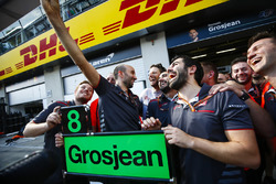 Romain Grosjean, Haas F1 Team, and the Haas F1 team celebrate the team's best finish yet