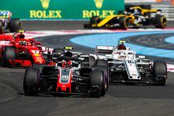 Kevin Magnussen, Haas F1 Team VF-18, leads Charles Leclerc, Sauber C37, and Kimi Raikkonen, Ferrari SF71H