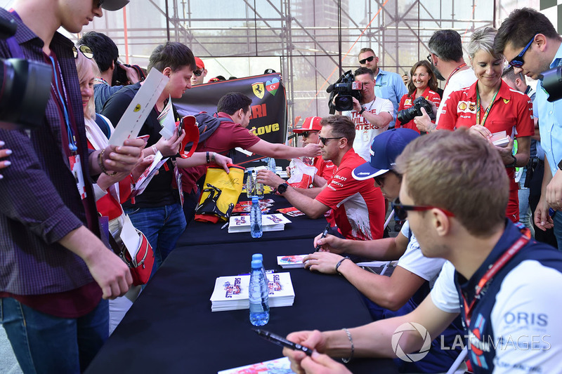 Sebastian Vettel, Ferrari and Kimi Raikkonen, Ferrari sign autographs for the fans