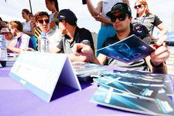 Nelson Piquet Jr., Jaguar Racing signs autographs for fans