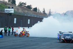 Marc Marquez, Dani Pedrosa, Repsol Honda Team perform burnouts with Honda NSX Super GT cars