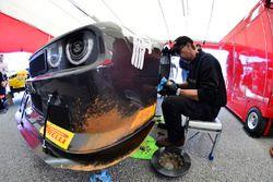 Crews work on the #77 TA2 Dodge Challenger: Paul Van Terry of Stevens Miller Racing