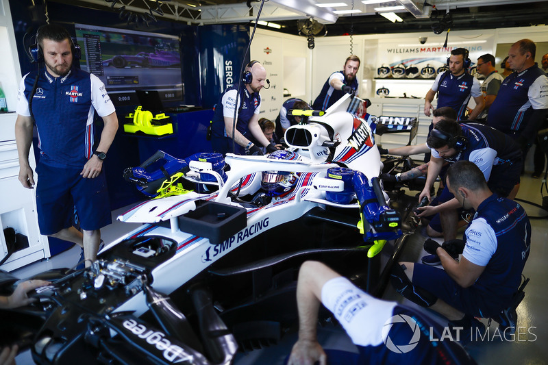 Engineers make adjustments to the car of Sergey Sirotkin, Williams FW41