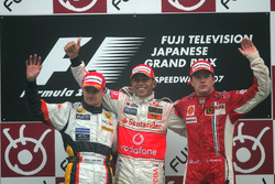 Heikki Kovalainen, Renault R27 with Lewis Hamilton, McLaren Mercedes MP4/22 and Kimi Raikkonen, Ferrari F2007 celebrate on the podium