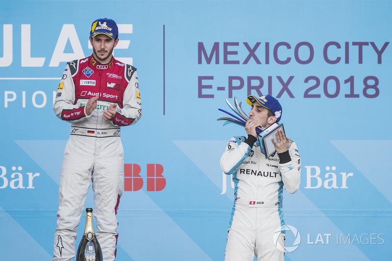Daniel Abt, Audi Sport ABT Schaeffler, celebrates on the podium after winning the race with Sébastien Buemi, Renault e.Dams