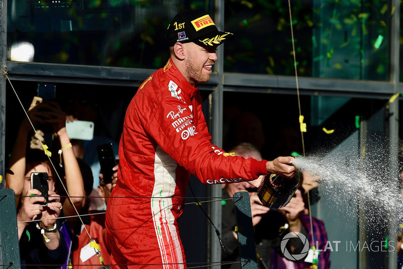 Race winner Sebastian Vettel, Ferrari celebrates on the podium with the champagne