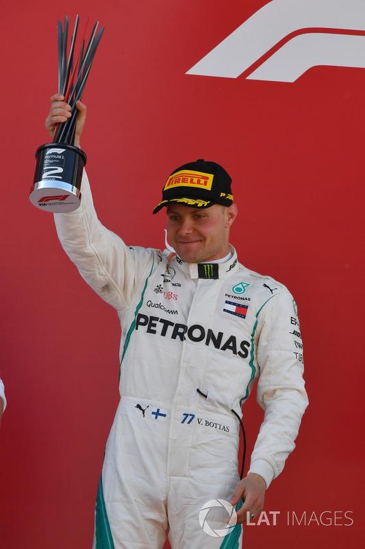 Valtteri Bottas, Mercedes-AMG F1 celebrates on the podium with the trophy