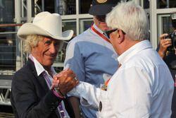 (L to R): Arturo Merzario, with Herbie Blash, FIA Delegate