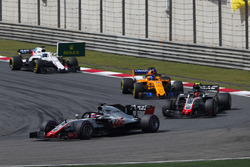 Romain Grosjean, Haas F1 Team VF-18 Ferrari, leads Kevin Magnussen, Haas F1 Team VF-18 Ferrari, and Fernando Alonso, McLaren MCL33 Renault