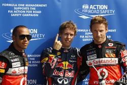 Polesitter Sebastian Vettel, Red Bull Racing, second place Lewis Hamilton, McLaren and third place Jenson Button, McLaren