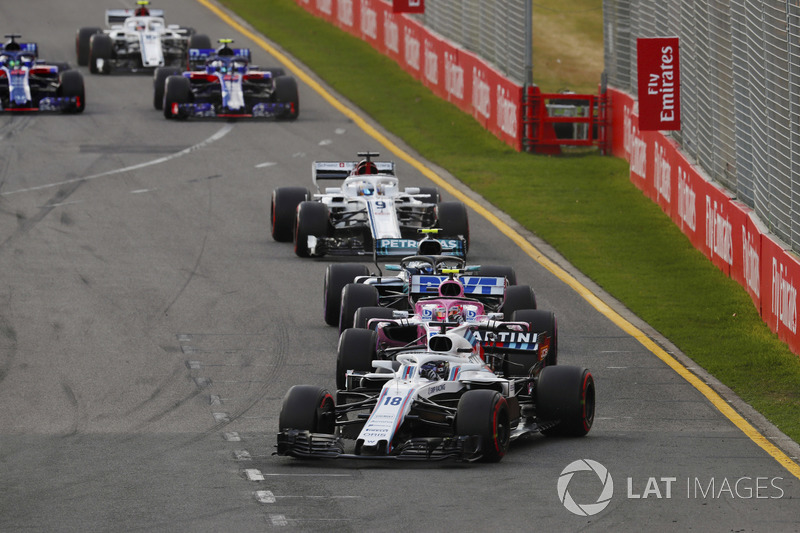 Lance Stroll, Williams FW41 Mercedes, Esteban Ocon, Force India VJM11 Mercedes, y Valtteri Bottas, Mercedes AMG F1 W09