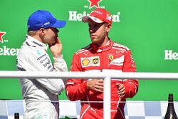 Podium: winnaar Sebastian Vettel, Ferrari, tweede Valtteri Bottas, Mercedes AMG F1