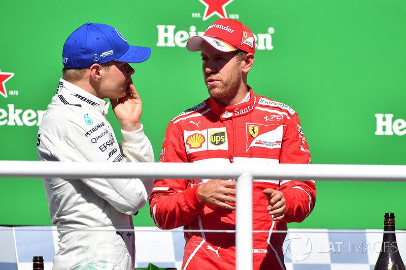 Podium: winner Sebastian Vettel, Ferrari, second place Valtteri Bottas, Mercedes AMG F1