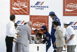 Podium: Nelson Piquet, Brabham, collapses through heat exhaustion