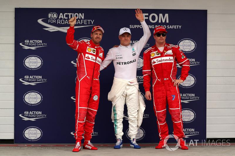 Top 3 Qualifiche: il poleman Valtteri Bottas, Mercedes AMG F1, il secondo qualificato Sebastian Vettel, Ferrari, il terzo qualificato Kimi Raikkonen, Ferrari
