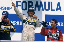 Podium: race winner Nelson Piquet, Williams, second place Ayrton Senna, Lotus, third place Nigel Mansell, Williams