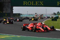 Sebastian Vettel, Ferrari SF71H and Kimi Raikkonen, Ferrari SF71H battle