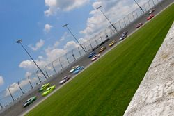The field races into turn two