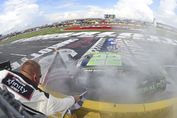Brad Keselowski, Team Penske, Ford Mustang Fitzgerald Glider Kits, does a burnout after winning