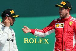 Sebastian Vettel, Ferrari en Lewis Hamilton, Mercedes AMG F1 op het podium