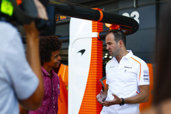 McLaren engineer Tom Stallard, talks to Blue Peter presenter Radzi Chinyanganya