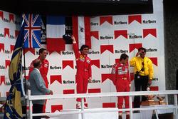 Podium: race winner Alain Prost, second place Nigel Mansell, third place Gerhard Berger