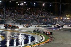 Sebastian Vettel, Ferrari SF70H leads at the start of the race as Fernando Alonso, McLaren MCL32, Ki