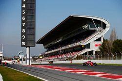 Kimi Raikkonen, Ferrari SF70H passes Carlos Sainz Jr., Scuderia Toro Rosso STR12, as Fernando Alonso
