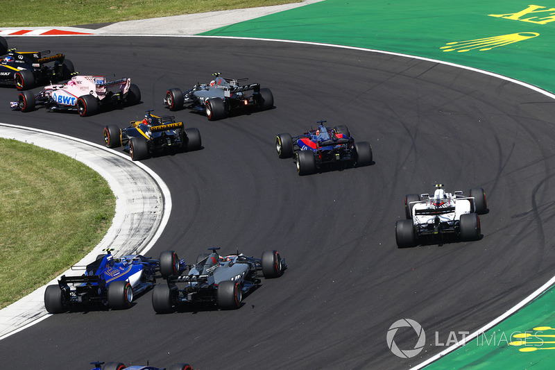 Lance Stroll, Williams FW40, Romain Grosjean, Haas F1 Team VF-17, Pascal Wehrlein, Sauber C36