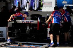 Conor Daly, A.J. Foyt Enterprises Chevrolet crew works on car in paddock garage