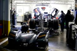 Mechanics working of the #70 Mazda Motorsports Mazda DPi: Joel Miller, Tom Long, James Hinchcliffe
