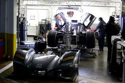 Mechanics working of the #70 Mazda Motorsports Mazda DPi: Joel Miller, Tom Long, James Hinchcliffe