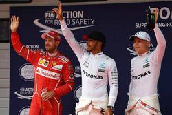 Sebastian Vettel, Ferrari, polesitter Lewis Hamilton, Mercedes AMG F1 and Valtteri Bottas, Mercedes