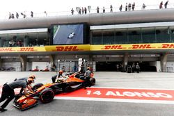 Fernando Alonso, McLaren MCL32, is wheeled back into his pit garage in the pit lane